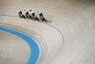 Members of the German men's track cycling team round the track during a training session inside the Izu velodrome at the 2020 Summer Olympics, Thursday, July 29, 2021, in Tokyo, Japan. (AP Photo/Thibault Camus)