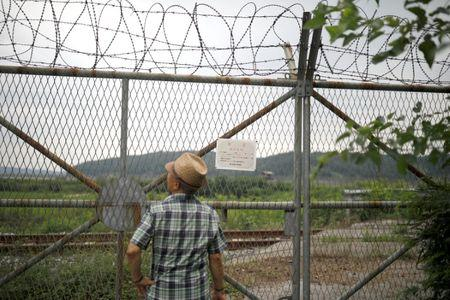 A man watches a barbed-wire fence near the demilitarized zone separating the two Koreas in Paju, South Korea, July 14, 2017. REUTERS/Kim Hong-Ji