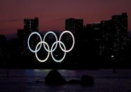 FILE PHOTO: The giant Olympic rings are seen in the dusk at the waterfront area at Odaiba Marine Park in Tokyo