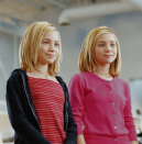 <p>We can't tell who is who, but both Mary-Kate and Ashley Olsen look cool as '90s cucumbers (it's a thing, roll with it) with their deep side parts and clips in <em>Switching Goals</em>. </p>