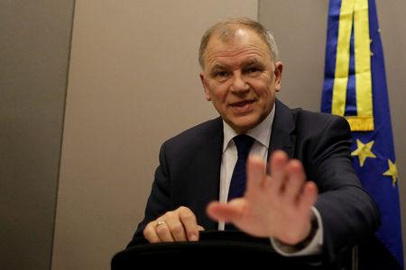 EU Commissioner for Health and Food Safety Vytenis Andriukaitis gestures after a news conference in Brasilia