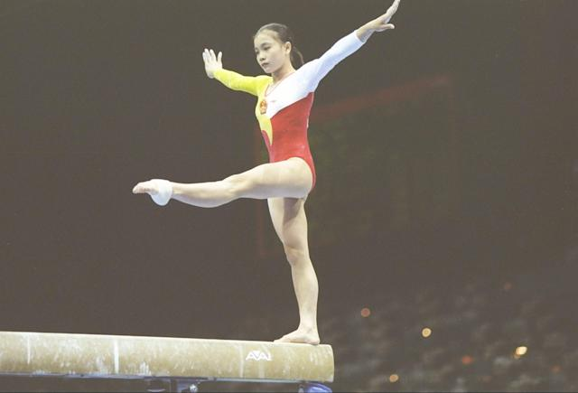 25 Jul 1996: Gymnast Huilan Mo of China performs on the balance beam during the Olympics at the Georgia Dome in Atlanta, Georgia.