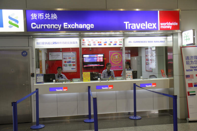 Shanghai Pudong International Airport, Currency exchange, Travelex, front window. (Photo by: Jeffrey Greenberg/Universal Images Group via Getty Images)