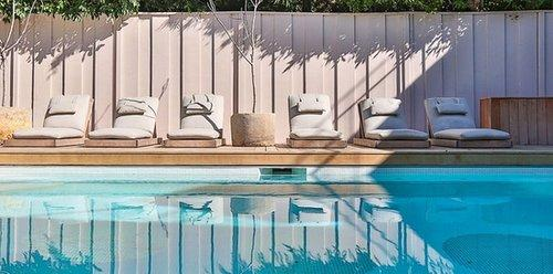 With six custom lounge chairs, the backyard is ideal for relaxing.  Source: Chris Cortazzo