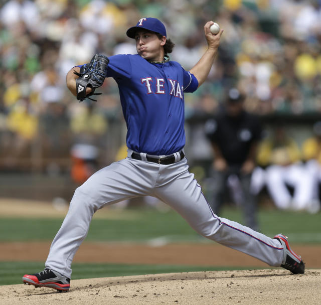 Texas Rangers' Derek Holland works against the Oakland Athletics in the first inning of a baseball game Monday, Sept. 2, 2013, in Oakland, Calif. (AP Photo/Ben Margot)