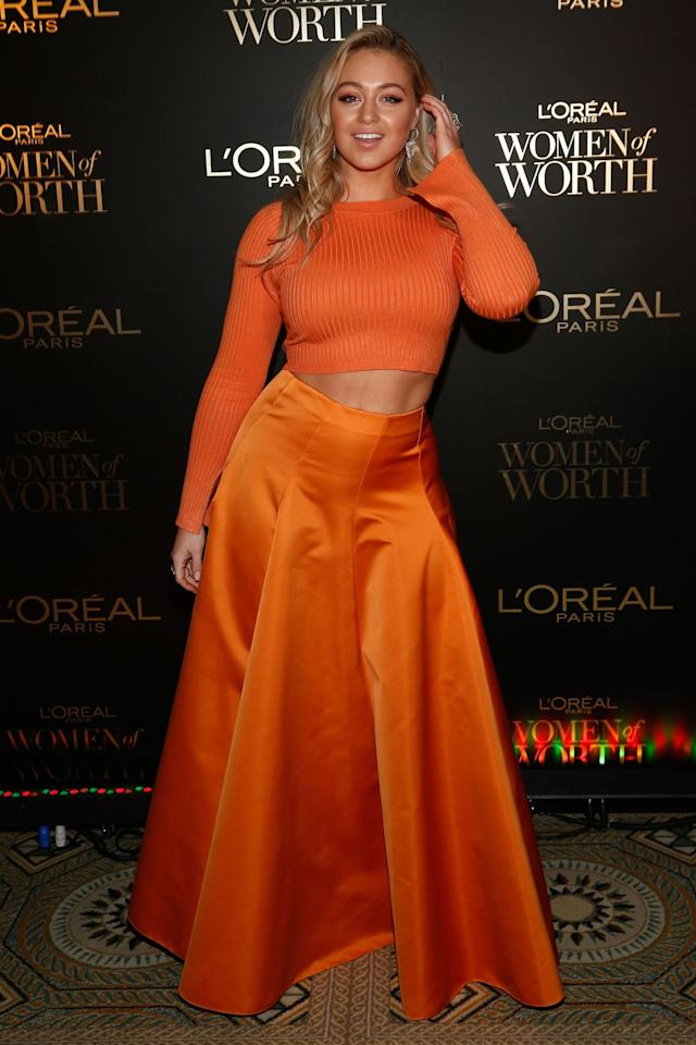 <p><strong>5 December </strong>Iskra Lawerence paired a vibrant orange skirt with a matching crop-top. <strong></strong></p>
