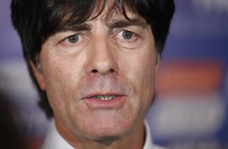 Germany head coach Joachim Loew answers questions after the draw ceremony for the 2014 soccer World Cup in Costa do Sauipe near Salvador, Brazil, Friday, Dec. 6, 2013. (AP Photo/Victor R. Caivano)