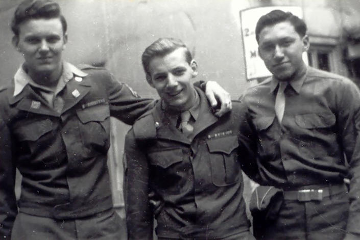 This 1944 photo provided by Russell Contreras shows U.S. Army Pvt. Carlos Contreras, right, of Houston, posing with fellow soldiers in New York before heading to Europe for the invasion of Germany. In an essay, Associated Press writer Russell Contreras says the July Fourth holiday as a Mexican American has always troubled him because of his family's history in the U.S. But his grandfather Carlos and his Uncle Ciprian Contreras' heroics as a U.S. Marine at Iwo Jima in 1945 makes him look at America's Independence Day differently. (Courtesy of Russell Contreras via AP)