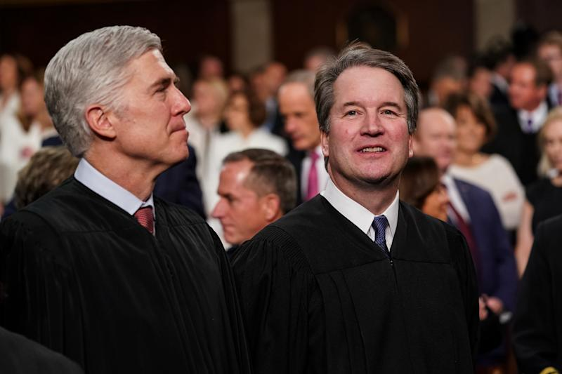 Neil Gorsuch, associate justice of the U.S. Supreme Court, left, and Brett Kavanaugh, associate justice of the U.S. Supreme Court, attend the U.S. President Donald Trump's State of the Union address to a joint session of Congress at the U.S. Capitol in Washington, D.C., U.S., on Feb. 5, 2019. (Photo: Doug Mills/Pool via Bloomberg/Getty Images)