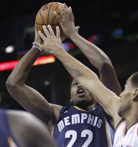 Memphis Grizzlies forward Rudy Gay shoots under pressure from Oklahoma City Thunder guard Thabo Sefolosha, right, in the first quarter of an NBA basketball game in Oklahoma City, Wednesday, Nov. 14, 2012. (AP Photo/Sue Ogrocki)