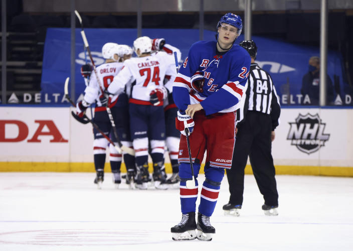New York Rangers' Kaapo Kakko (24) skates back to the bench as the Washington Capitals celebrate a second-period goal by Nic Dowd during an NHL hockey game Wednesday, May 5, 2021, in New York. (Bruce Bennett/Pool Photo via AP)