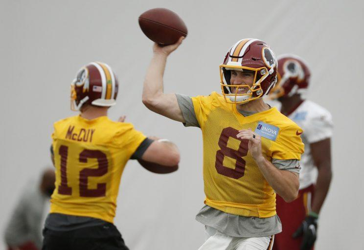 Kirk Cousins will play on the franchise tag for a second straight season. (AP)