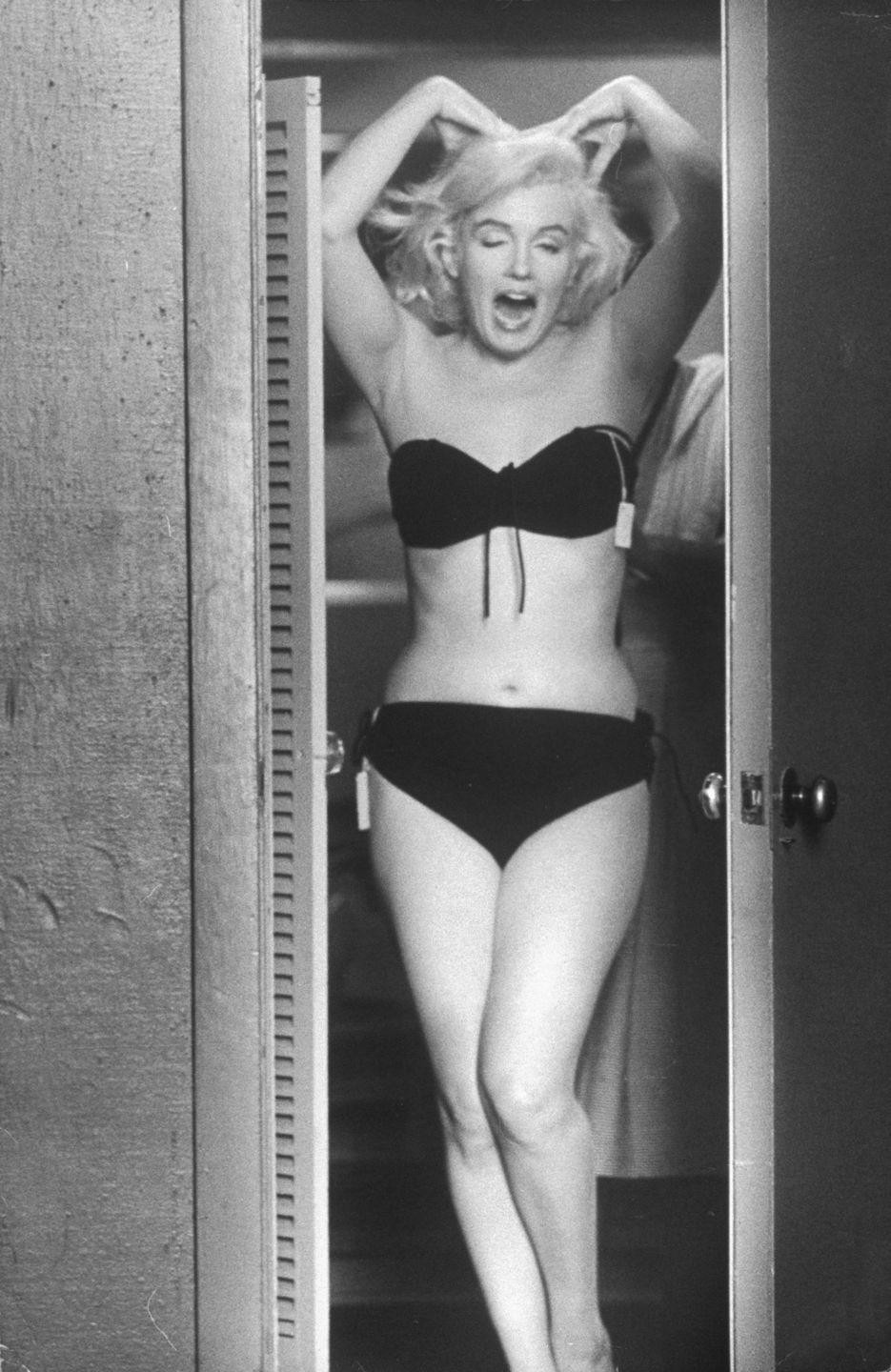<p>The actress poses for husband Arthur in a dressing room doorway after putting on a bikini she purchased. </p>