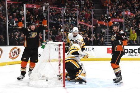 Jan 11, 2019; Anaheim, CA, USA Anaheim Ducks center Adam Henrique (14) and left wing Nick Ritchie (37) celebrate after scoring a goal as Pittsburgh Penguins goaltender Matt Murray (30) reacts in the first period at the Honda Center. Mandatory Credit: Kirby Lee-USA TODAY Sports