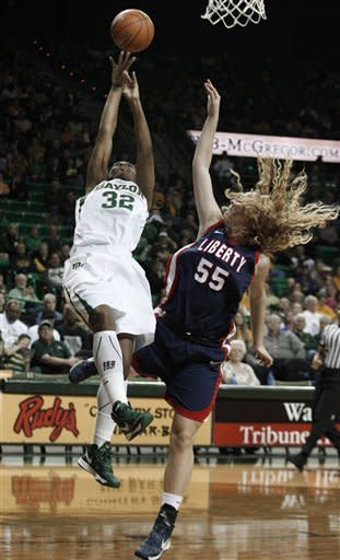Baylor's Brooklyn Pope (32) shoots against LIberty's Ashley Rininger (32) during the first half of an NCAA college basketball game Friday, Nov. 23, 2012, in Waco, Texas. (AP Photo/LM Otero)