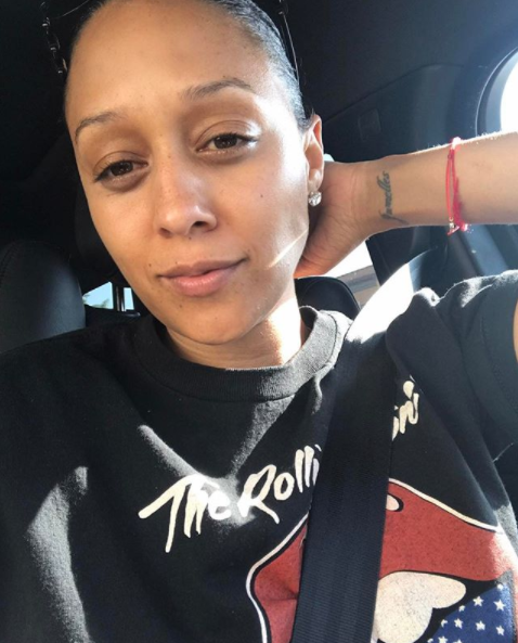 <p>The working mom is down for anything with her hair pulled back. (Photo: Instagram/tiamowry) </p>