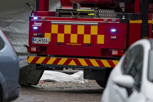 <p>The shrouded body of a stabbing victim on the Turku Market Square on Aug. 18, 2017, after several people were stabbed. (Roni Lehti/Lehtikuva via AP) </p>