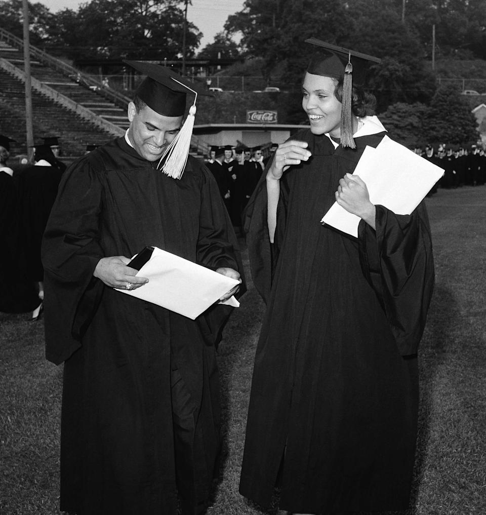 Hamilton Holmes and Charlayne Hunter of Atlanta examine diplomas awarded during the University of Georgia's 160th commencement in Athens, Georgia, June 3, 1963. They were the first Black students to attend the nation's oldest land grant college.