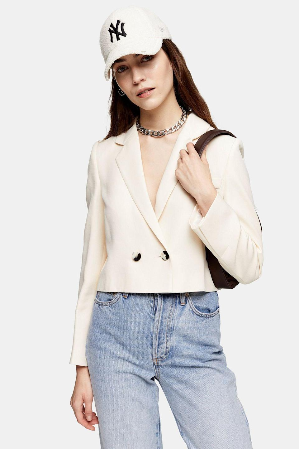 """<p><strong>Topshop</strong></p><p>topshop.com</p><p><strong>$85.00</strong></p><p><a href=""""https://go.redirectingat.com?id=74968X1596630&url=https%3A%2F%2Fus.topshop.com%2Fen%2Ftsus%2Fproduct%2Fcrop-sb-ivr-9406976&sref=https%3A%2F%2Fwww.cosmopolitan.com%2Fstyle-beauty%2Ffashion%2Fg30933395%2Ffall-fashion-trends-2020%2F"""" rel=""""nofollow noopener"""" target=""""_blank"""" data-ylk=""""slk:Shop Now"""" class=""""link rapid-noclick-resp"""">Shop Now</a></p><p>Grab a simple blazer that's long enough for business, but short enough to be considered cropped. </p>"""