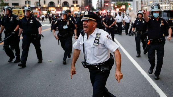 PHOTO: NYPD officers move in to arrest protesters for violating curfew beside the iconic Plaza Hotel on 59th Street, June 3, 2020, in the Manhattan borough of New York City. (John Minchillo/AP)