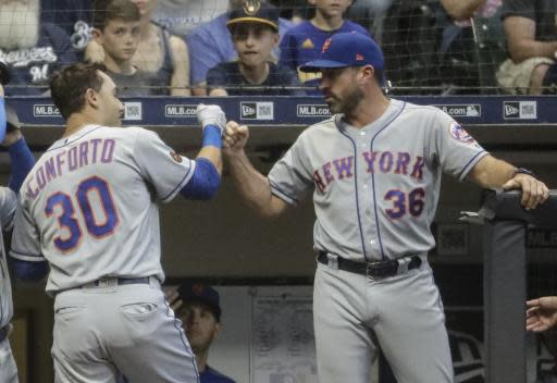 New York Mets manager Mickey Callaway congratulates Michael Conforto after his home run during the fourth inning of a baseball game against the Milwaukee Brewers Friday, May 25, 2018, in Milwaukee. (AP Photo/Morry Gash)