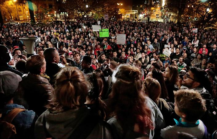 <p>A few thousand protesters gather for a rally on the State Street steps of the State Capitol after marching from UW-Madison, protesting President-elect Donald Trump Thursday, Nov. 10, 2016, in Madison, Wis. (Photo: Michael P. King/Wisconsin State Journal via AP) </p>
