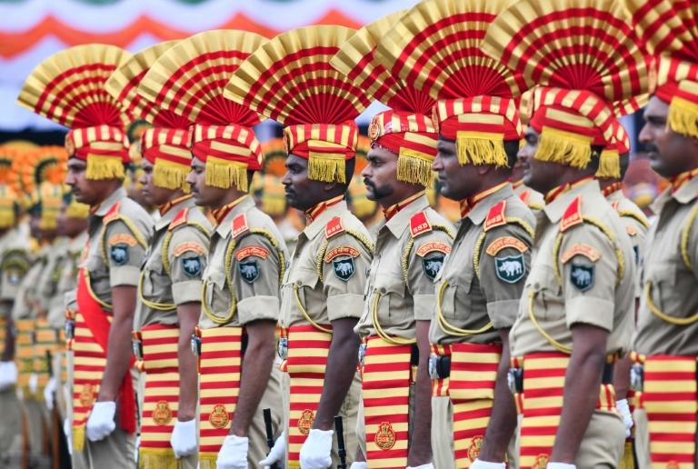 Indian servicemen stand in colourful formation during Independence Day celebrations (AFP Photo/Biju BORO)