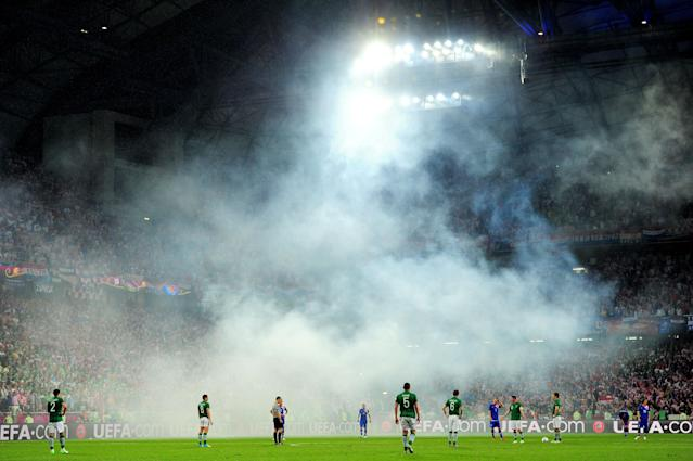 POZNAN, POLAND - JUNE 10: Play is briefly stopped to remove a flare from the field of play during the UEFA EURO 2012 group C between Ireland and Croatia at The Municipal Stadium on June 10, 2012 in Poznan, Poland. (Photo by Jamie McDonald/Getty Images)