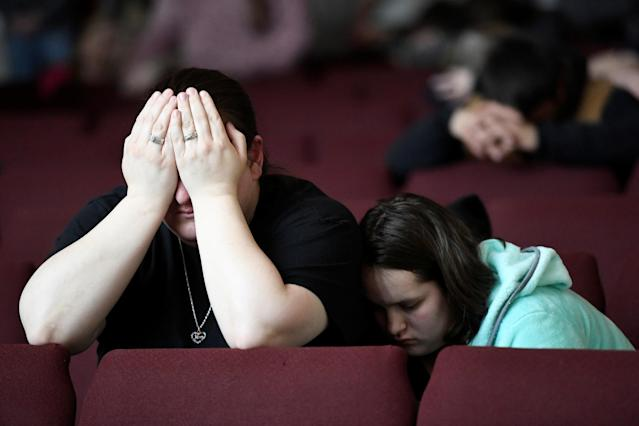 <p>Tiffany Moreland and her daughter Emily Moreland attend a prayer vigil for students killed and injured after a 15-year-old boy opened fire with a handgun at Marshall County High School, at Life in Christ Church in Marion, Kentucky, Jan. 23, 2018. (Photo: Harrison McClary/Reuters) </p>