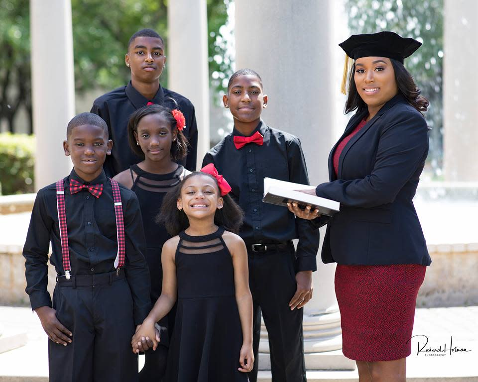 This single mom's graduation photos went viral months ago. Now she's officially an attorney. (Photo: Richard Holman Photography)