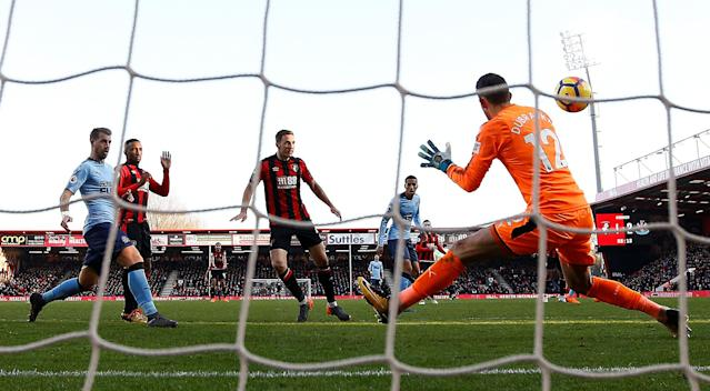 """Soccer Football - Premier League - AFC Bournemouth vs Newcastle United - Vitality Stadium, Bournemouth, Britain - February 24, 2018 Bournemouth's Dan Gosling scores their second goal REUTERS/Peter Nicholls EDITORIAL USE ONLY. No use with unauthorized audio, video, data, fixture lists, club/league logos or """"live"""" services. Online in-match use limited to 75 images, no video emulation. No use in betting, games or single club/league/player publications. Please contact your account representative for further details."""