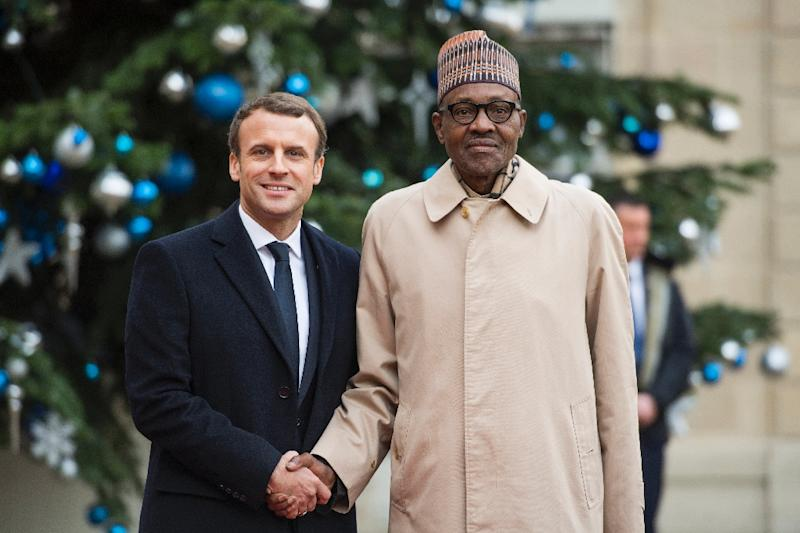 Buhari, seen here in Paris in December 2017 alongside French President Emmanuel Macron, has appeared frail but resumed his public engagements (AFP Photo/CHRISTOPHE ARCHAMBAULT )