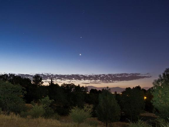 """Skywatcher Cory Poole sent this photo of Jupiter and Venus seen from Redding, CA, on July 5, 2012. Poole writes: """"You can see Venus passing through the Hyades open star cluster with Jupiter and the Pleiades above that. The foreground was illum"""