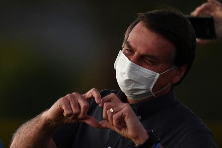 Until he was infected, Brazilian President Jair Bolsonaro regularly hit the streets of Brasilia without a face mask, exchanging hugs and handshakes with supporters
