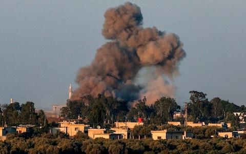 Israeli-annexed Golan Heights shows a smoke plume rising during air strikes backing a Syrian-government-led offensive in the southwestern province of Deraa. - Credit: AFP