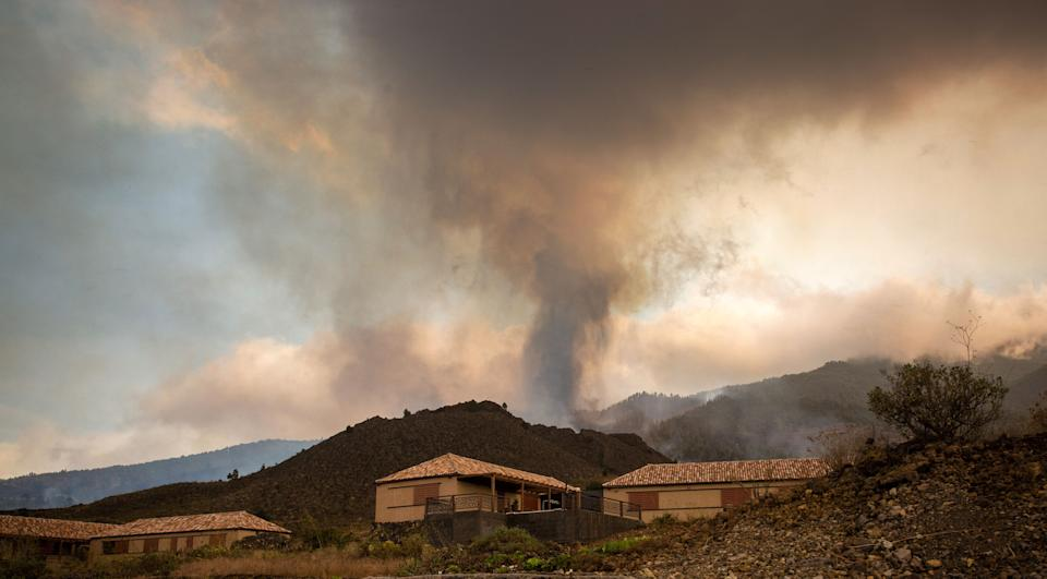 Smoke rises from cooling lava in the residential area of Los Campitos at Los Llanos de Aridane, on the Canary Island of La Palma on September 20, 2021. - A surge of  lava destroyed around 100 homes on Spain's Canary Islands a day after a volcano erupted, forcing 5,000 people to leave the area. The Cumbre Vieja erupted on Sunday, sending vast plumes of thick black smoke into the sky and belching molten lava that oozed down the mountainside on the island of La Palma. (Photo by DESIREE MARTIN / AFP) (Photo by DESIREE MARTIN/AFP via Getty Images)