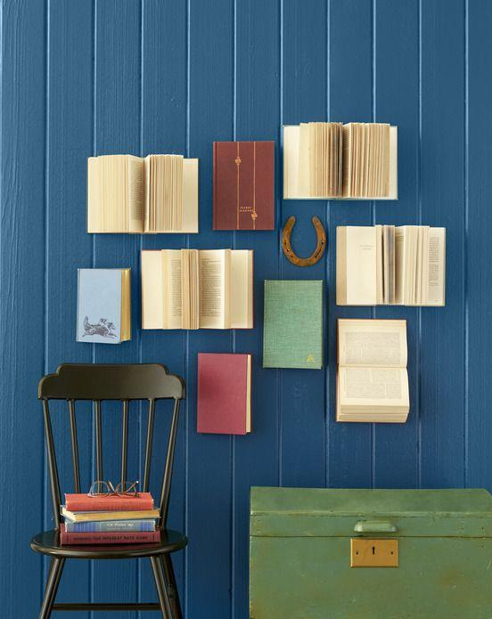 <p>Arrange books in a fun, slightly haphazard pattern, putting heavy-duty nails or staples through the back covers to secure. For extra texture, hold some pages open with string or fishing line.</p>