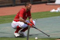 Cincinnati Reds' Nick Senzel stretches during team baseball practice at Great American Ballpark in Cincinnati, Friday, July 3, 2020. (AP Photo/Aaron Doster)