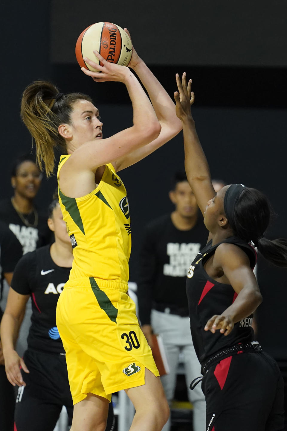 Seattle Storm forward Breanna Stewart (30) shoots over Las Vegas Aces guard Jackie Young (0) during the second half of Game 1 of basketball's WNBA Finals Friday, Oct. 2, 2020, in Bradenton, Fla. (AP Photo/Chris O'Meara)
