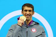 """Gold medalist <a href=""""http://sports.yahoo.com/olympics/swimming/michael-phelps-1131796/"""" data-ylk=""""slk:Michael Phelps"""" class=""""link rapid-noclick-resp"""">Michael Phelps</a> of the United States poses on the podium during the medal ceremony for the Men's 100m Butterfly Final on Day 7 of the London 2012 Olympic Games at the Aquatics Centre on August 3, 2012 in London, England. (Photo by Al Bello/Getty Images)"""