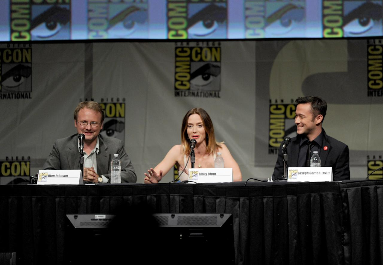 "SAN DIEGO, CA - JULY 13:  (L-R) Director Rian Johnson, actors Emily Blunt, and Joseph Gordon-Levitt speak during Sony's ""Looper"" panel during Comic-Con International 2012 at San Diego Convention Center on July 13, 2012 in San Diego, California.  (Photo by Kevin Winter/Getty Images)"