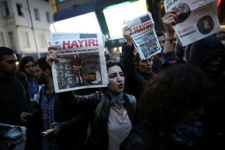 """Anti-government protesters shout slogans and hold leaflets that read """"No"""" during a demonstration at the Besiktas district in Istanbul, Turkey, April 17, 2017. REUTERS/Alkis Konstantinidis"""