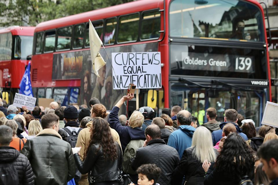 LONDON, UNITED KINGDOM - OCTOBER 17: Members of StandUpX stage a protest against coronavirus (Covid-19) measures and vaccine despite social gatherings of more than six people are not be allowed within Covid-19 measures in London, United Kingdom on October 17, 2020. (Photo by Hasan Esen/Anadolu Agency via Getty Images)