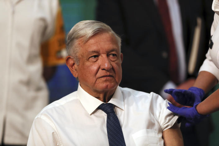 Mexican President Andres Manuel Lopez Obrador sits still moments after a nurse gave him a shot of the AstraZeneca vaccine for COVID-19 during his daily, morning news conference at the presidential palace in Mexico City, Tuesday, April 20, 2021. (AP Photo/Fernando Llano)