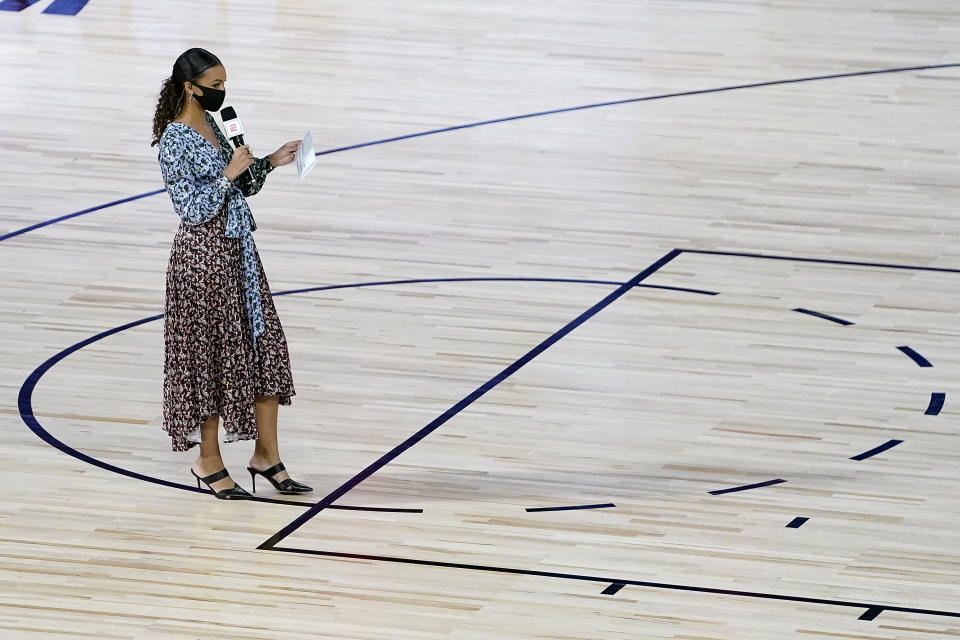 Malika Andrews stands on the court prior to a game.