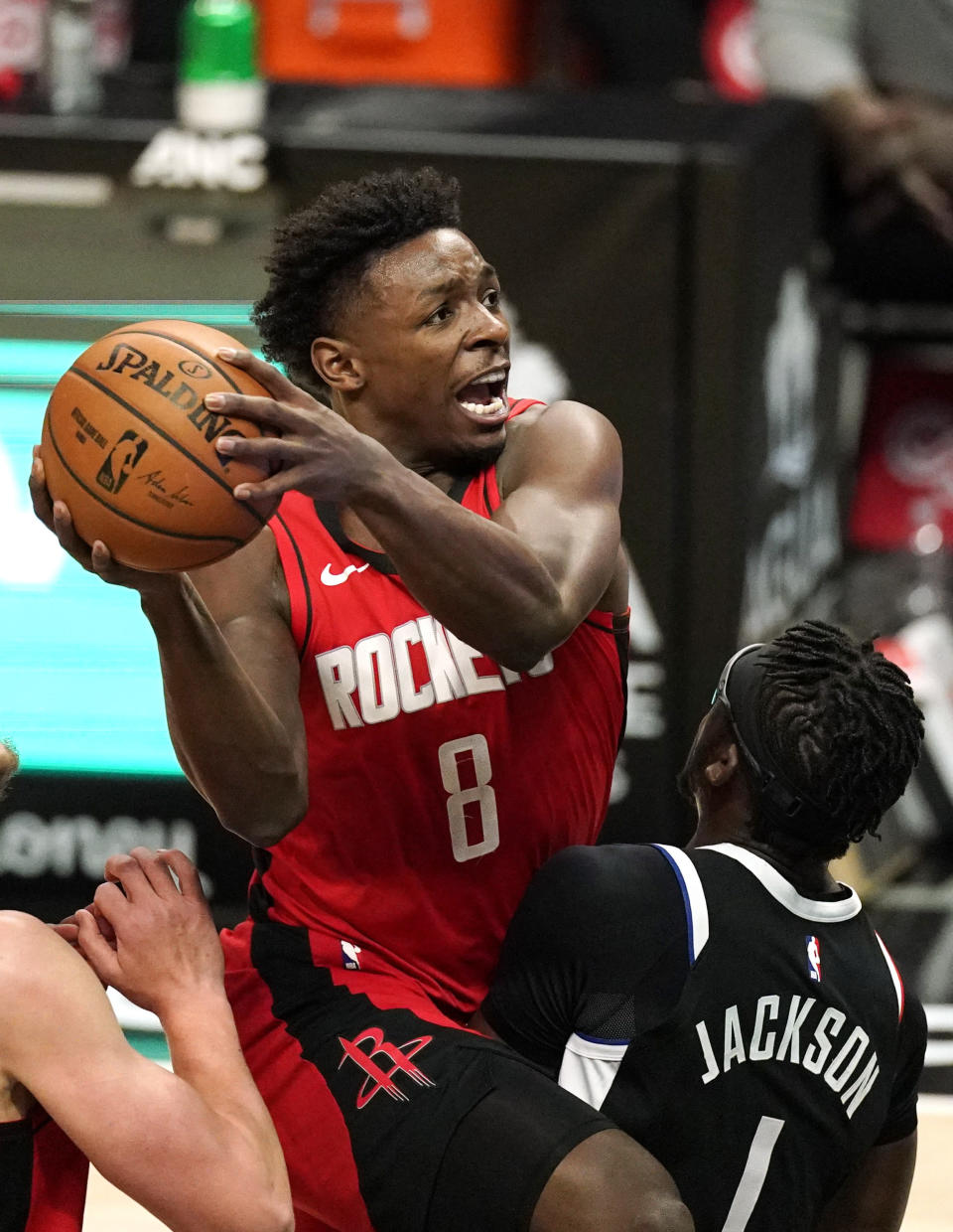 Houston Rockets forward Jae'Sean Tate, left, shoots as Los Angeles Clippers guard Reggie Jackson defends during the first half of an NBA basketball game Friday, April 9, 2021, in Los Angeles. (AP Photo/Mark J. Terrill)