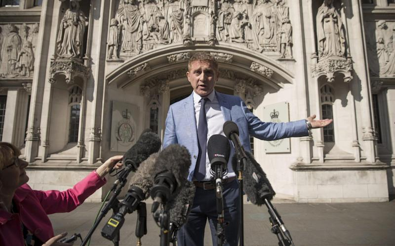 Jon Platt speaks to the media outside the Supreme Court after the judges ruled against him - Getty Images Europe