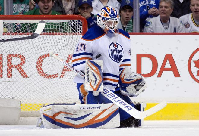 VANCOUVER, CANADA - APRIL 7: Goalie Devan Dubnyk #40 of the Edmonton Oilers makes a save against the Vancouver Canucks during the first period in NHL action on April 07, 2012 at Rogers Arena in Vancouver, British Columbia, Canada.  (Photo by Rich Lam/Getty Images)