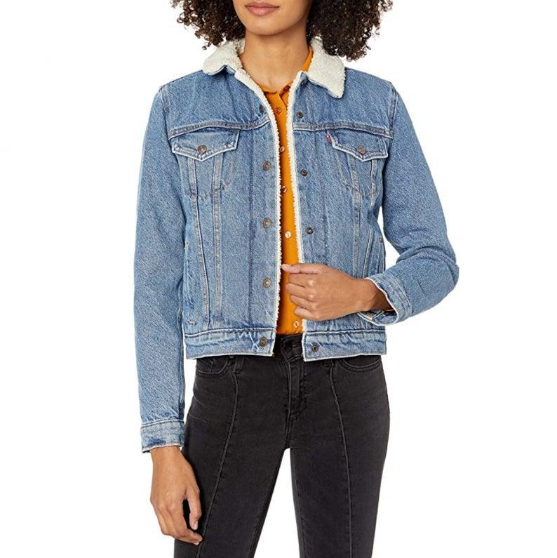 """Another Levi's steal—this time in the form of a super cozy, sherpa-lined trucker jacket. $98, Amazon. <a href=""""https://www.amazon.com/Levis-Original-Trucker-Jackets-Divided/dp/B072L2C8MD/"""" rel=""""nofollow noopener"""" target=""""_blank"""" data-ylk=""""slk:Get it now!"""" class=""""link rapid-noclick-resp"""">Get it now!</a>"""