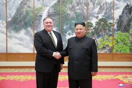 North Korean leader Kim Jong Un meets with U.S. Secretary of State Mike Pompeo in Pyongyang in this photo released by North Korea's Korean Central News Agency (KCNA) on October 7, 2018. KCNA via REUTERS  .